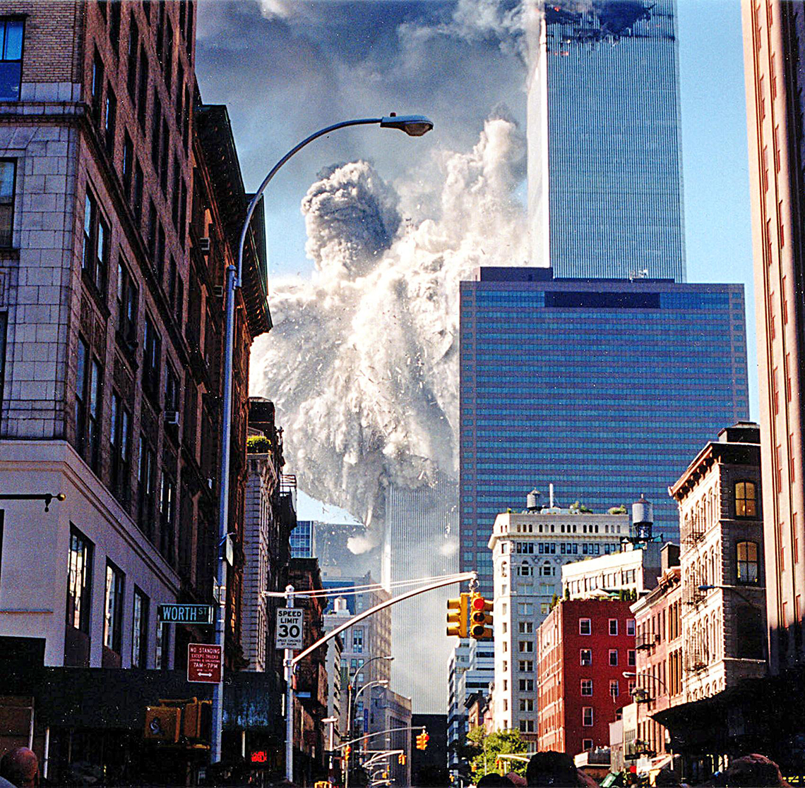 historical photo of the south tower collapsing as seen from blocks away in manhattan