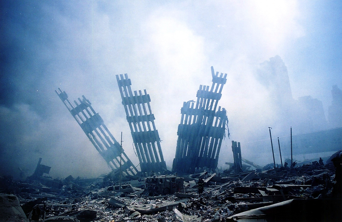 the wreckage of the world trade center is covered in smoke