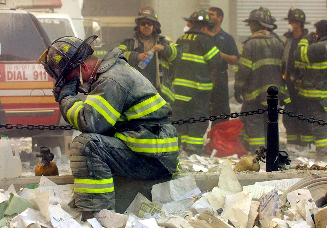 a ground zero a firefighter prays
