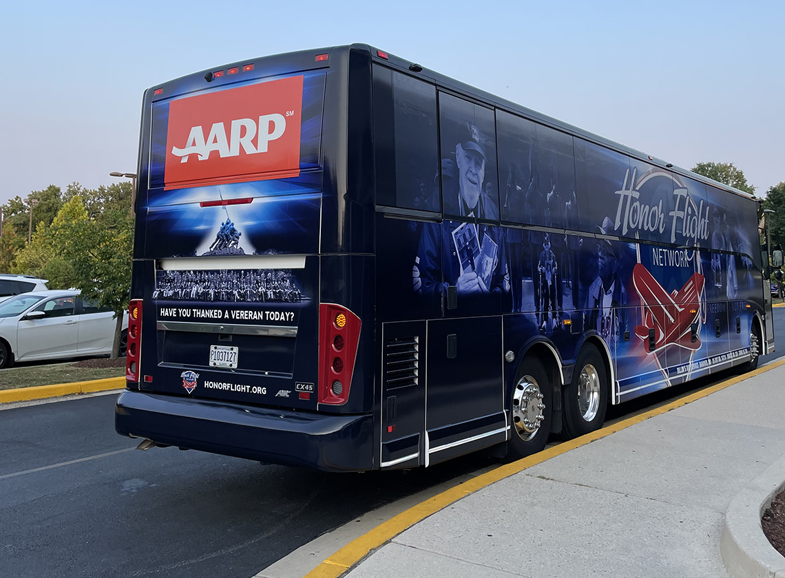 an honor flight bus sponsored by a a r p parks in washington d c