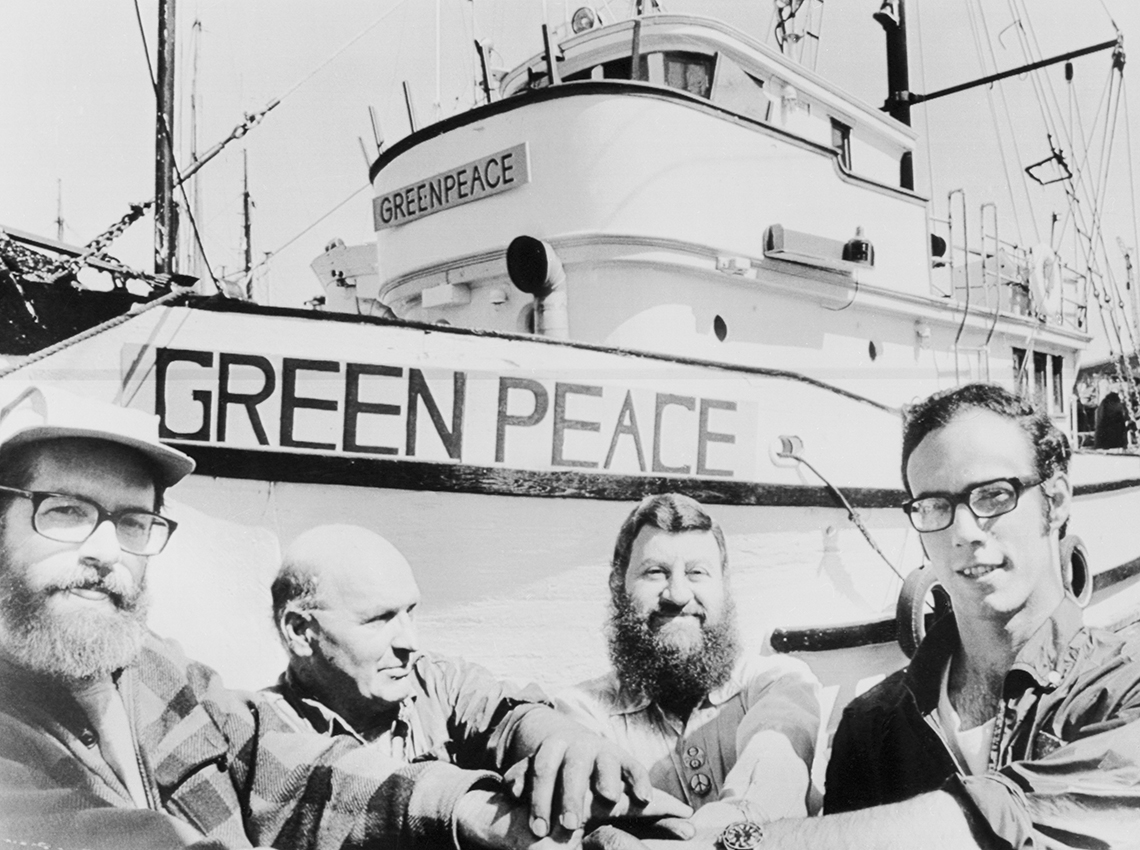 early photo of greenpeace activists and their first boat