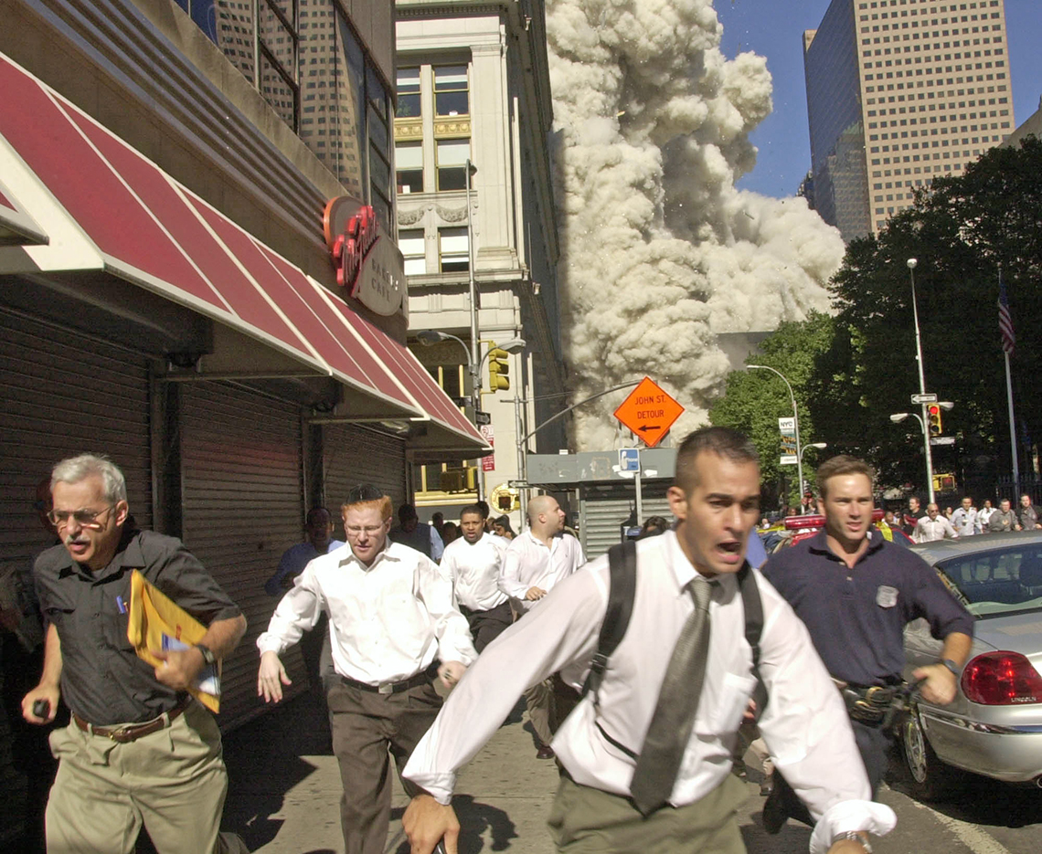men run from the scene of the world trade center explosions