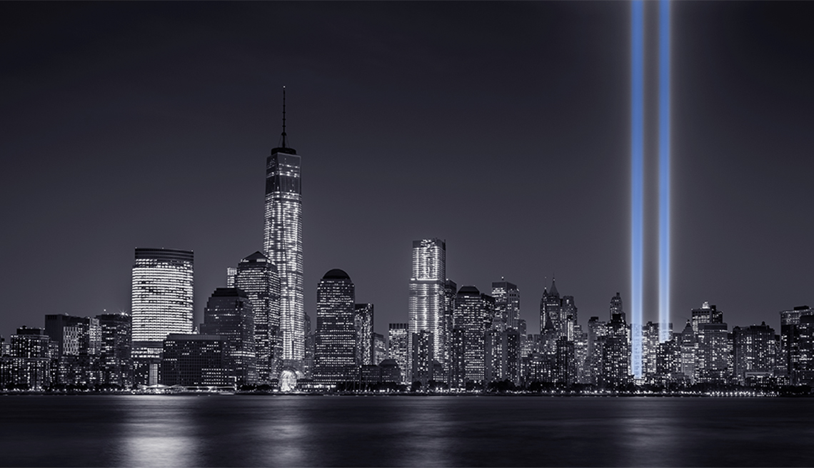 new york city skyline with the tribute in light memorial lit up