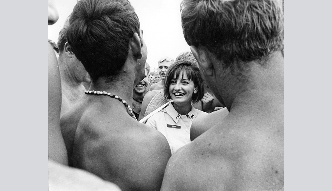 donut dolly barbara crippen is talking with a group of shirtless soldiers in vietnam