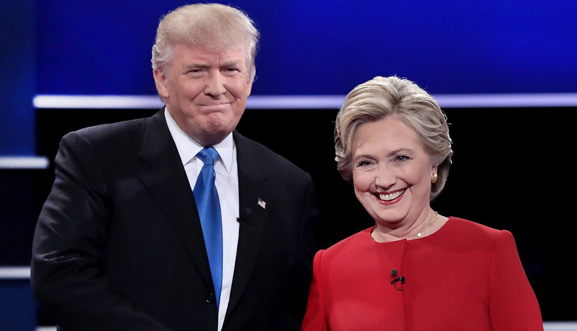 Democratic presidential nominee Hillary Clinton takes the stage with Republican presidential nominee Donald Trump during the first Presidential Debate