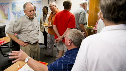 Volunteers, including AARP Wisconsin President Pat Killeen, get pointers from on facilitating You've Earned a Say sessions about Social Security and Medicare.