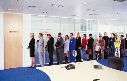 Long line of people waiting outside an office