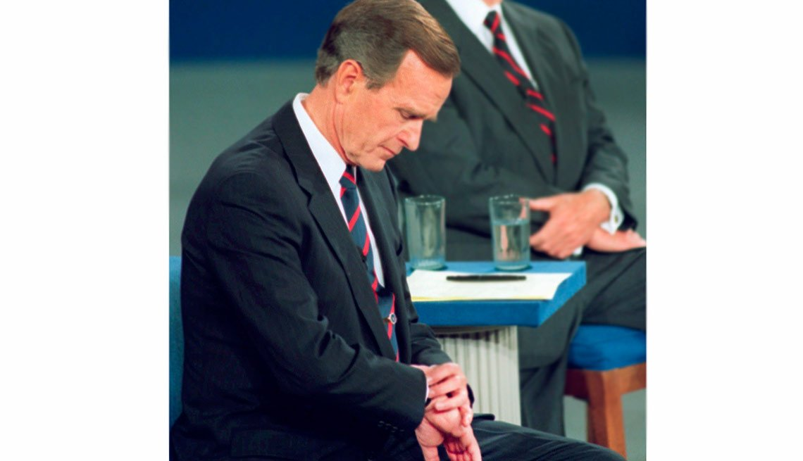 10 Weird things that happened during presidential campaigns - President George H.W. Bush looks at his watch