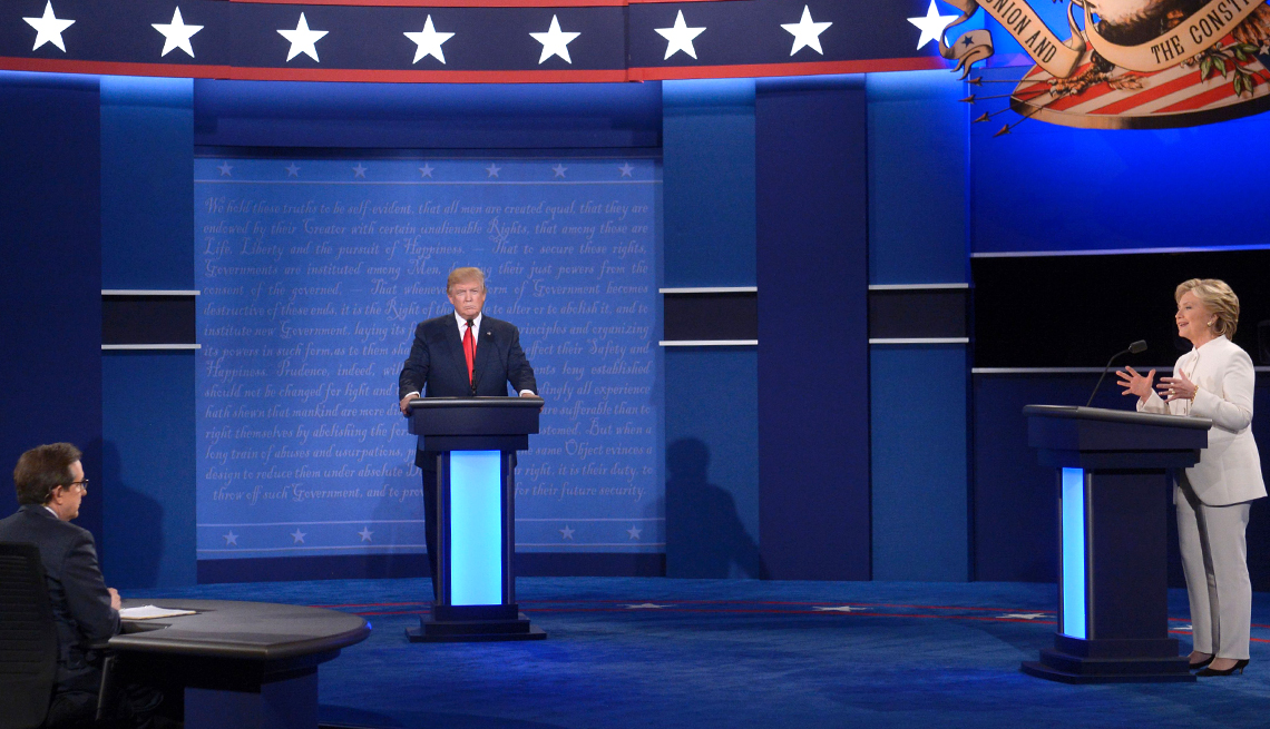 Presidential candidates Donald Trump and Hillary Clinton debate as moderator Chris Wallace of Fox News looks on