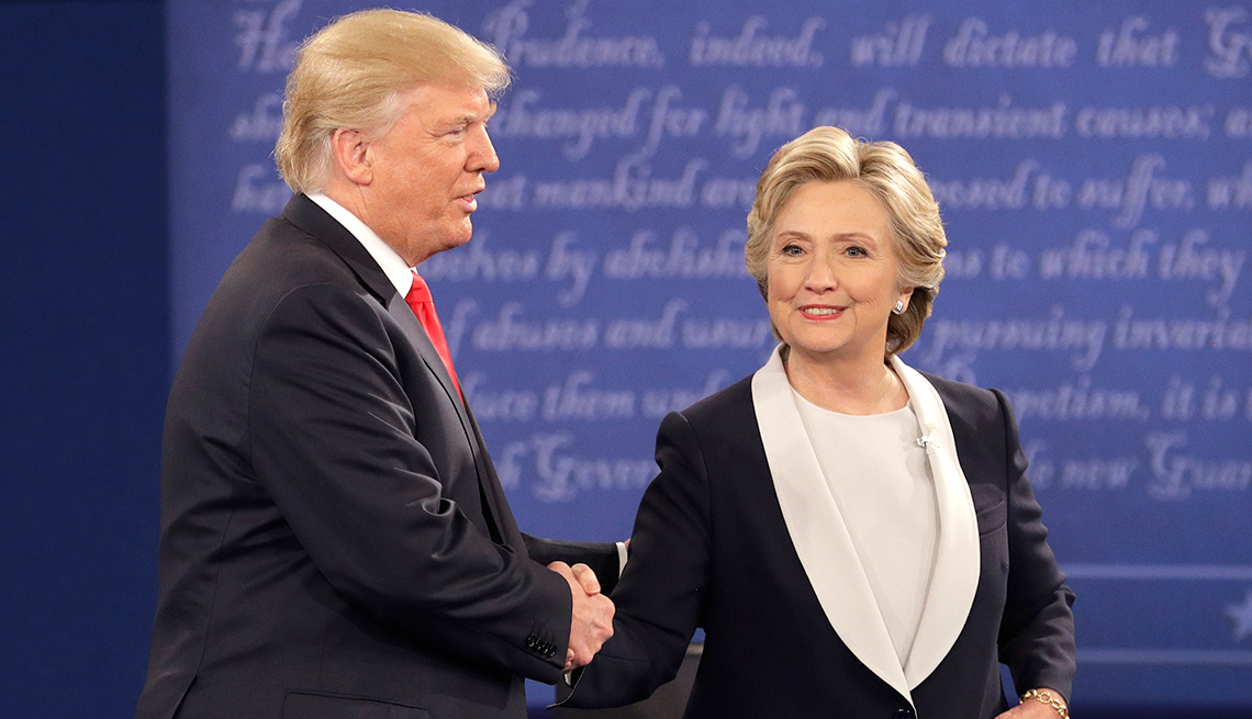 Candidates Trump and Clinton shake hands before the town hall debate