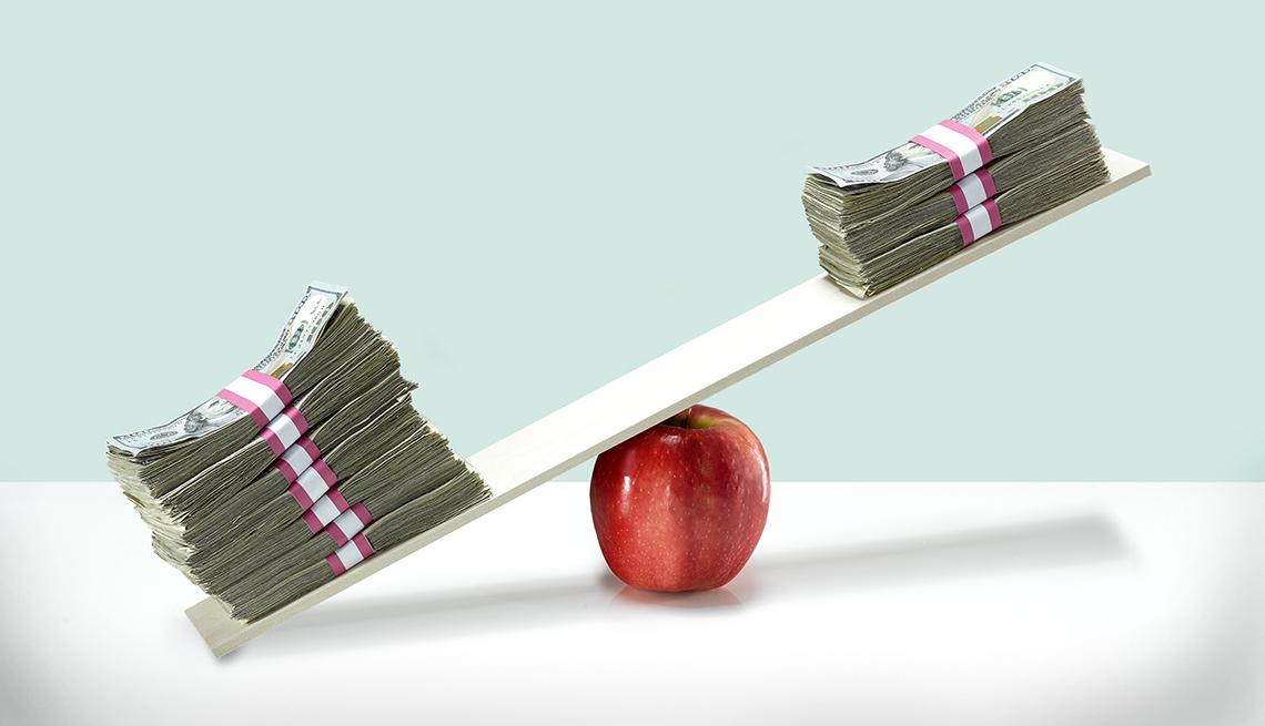 Money balancing on an apple.
