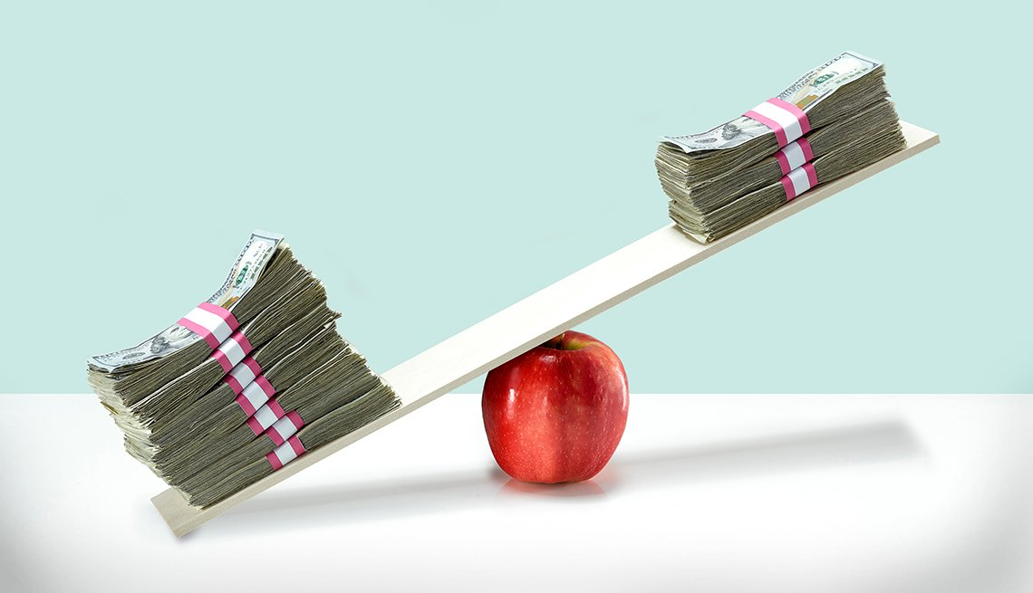 Money balancing on an apple.