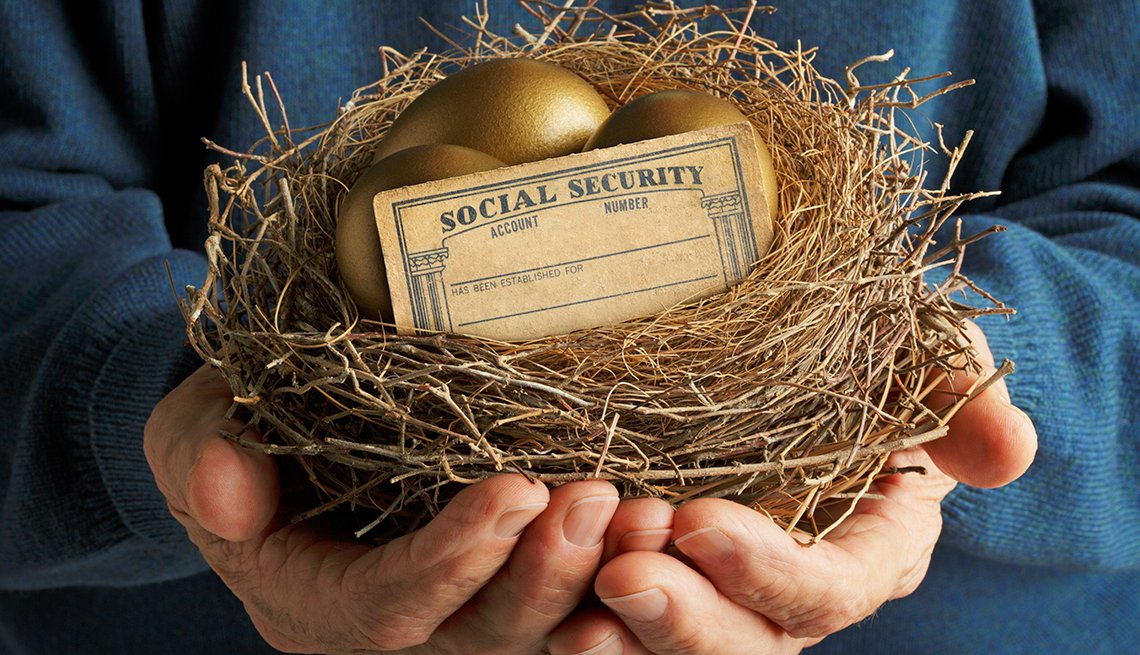 Person holding a nest with golden eggs and a Social Security card.