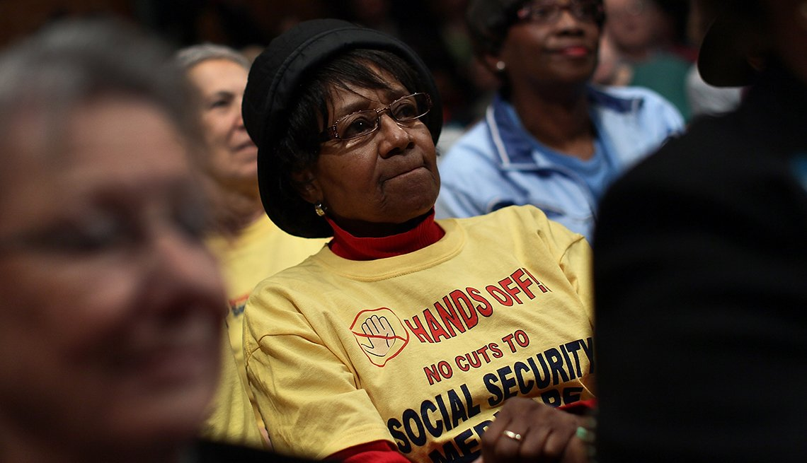 A woman listens to a hearing on Social Security.
