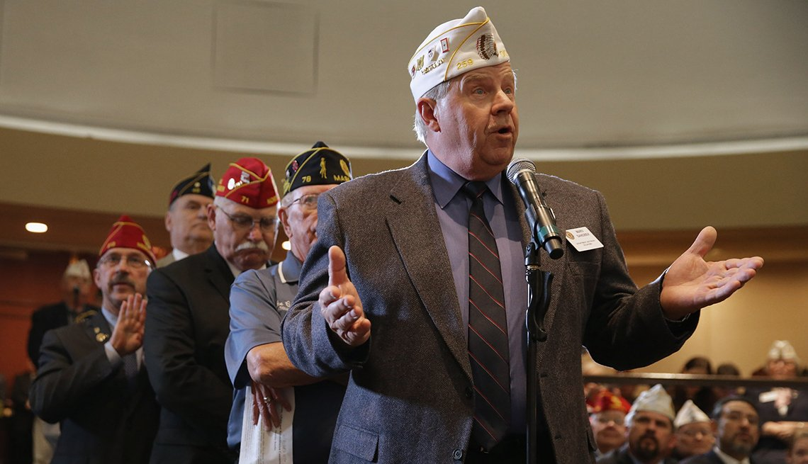 Veterans line up to ask questions at an American Legion conference.