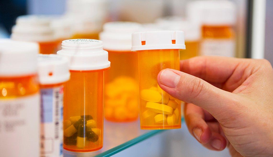 Pill bottles in a medicine cabinet