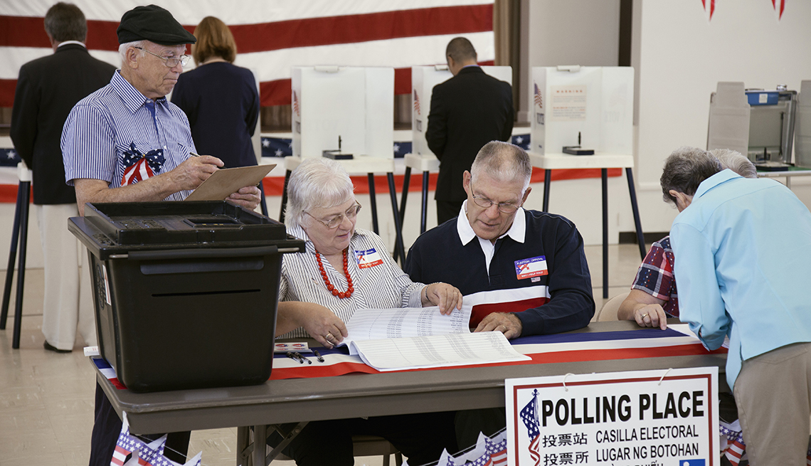 People working at a polling place during an election