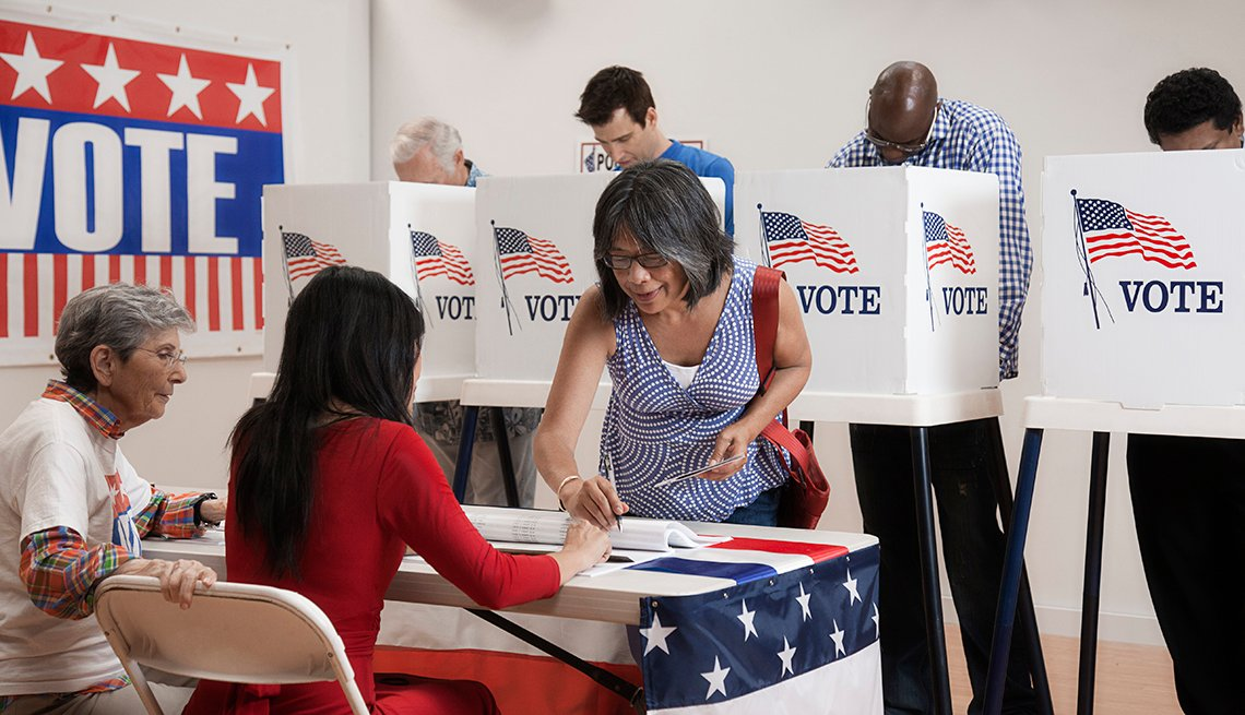 People voting at a polling place.