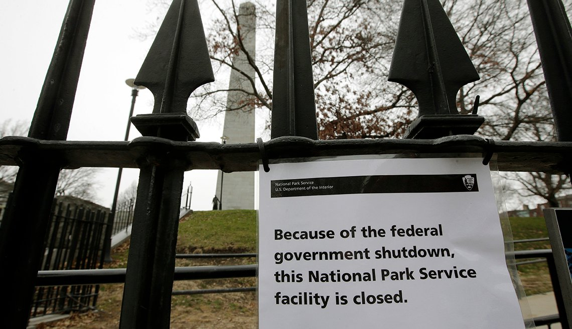 A park outside of Boston with a sign saying it's closed.