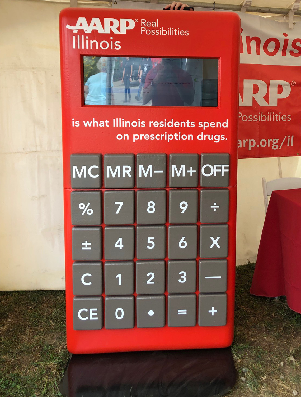 Red calculator showing the cost of prescription drugs in Illinois