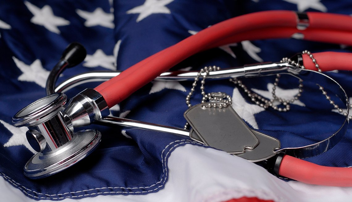 Dog tags and a stethoscope on the American flag