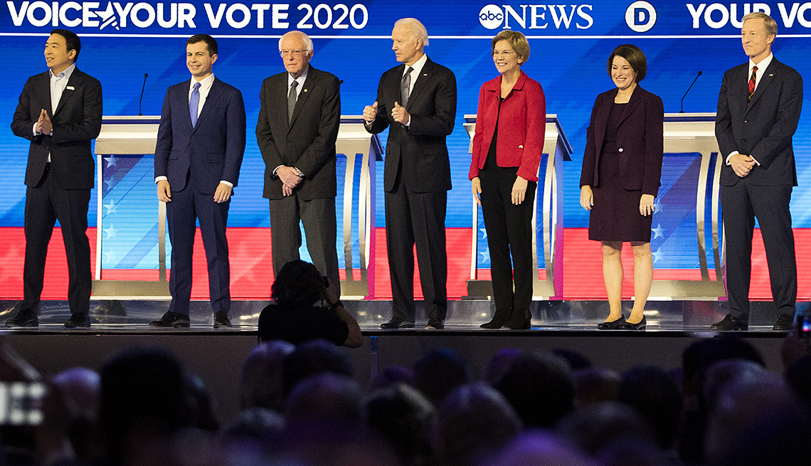 Democratic presidential candidates stand on the stage
