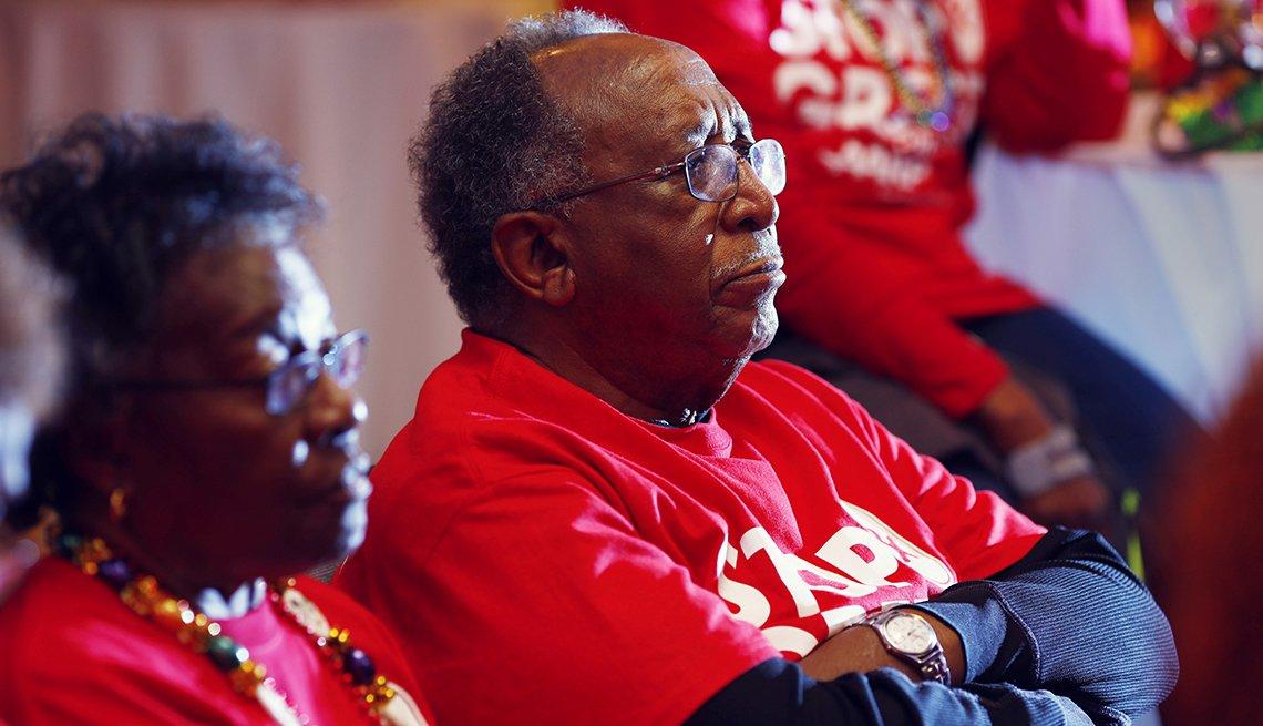 Volunteers wearing red shirts watching the debate in South Carolina
