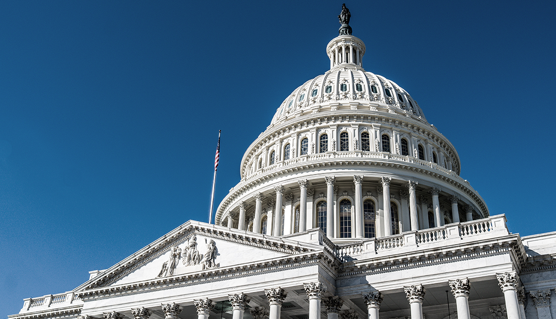 The dome of the United State Capitol against a deep blue sky in Washington, DC