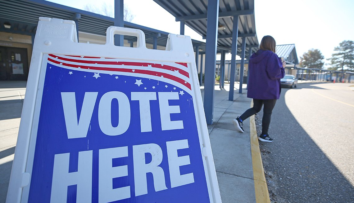 A female voter leaves a polling place