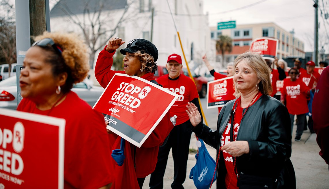 Volunteers in South Carolina walk the streets in red shirts
