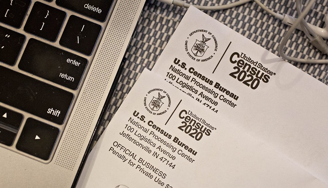 Census forms next to a computer