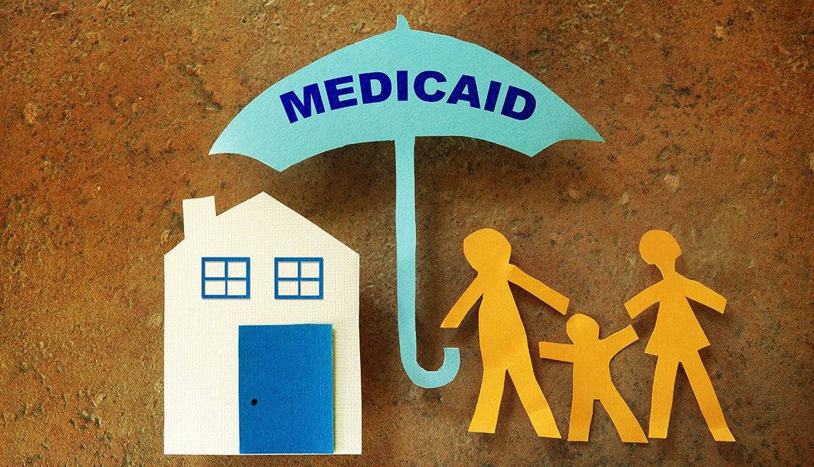 paper cut out illustration of a house and family covered with an umbrella that says medicaid