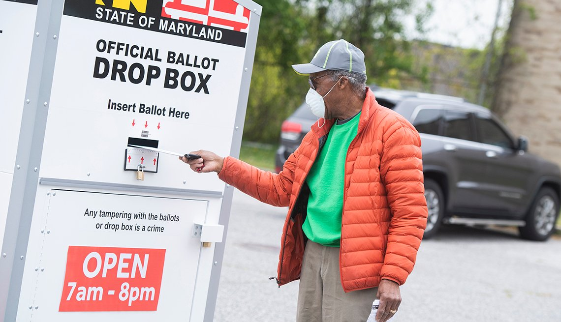 A person turns in his ballot at a drop box