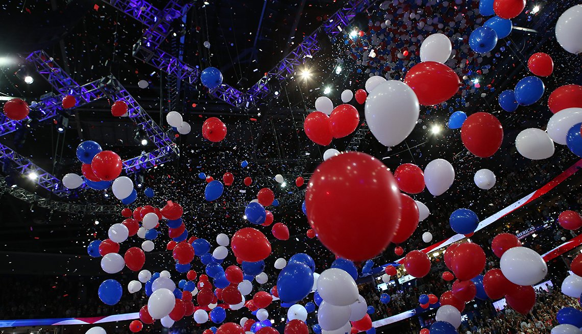 political convention red white and blue balloon drop in an arena