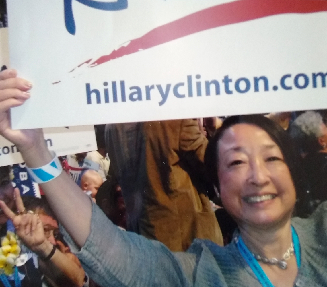jadine nielsen holding a hillary clinton sign at a past democratic national convention