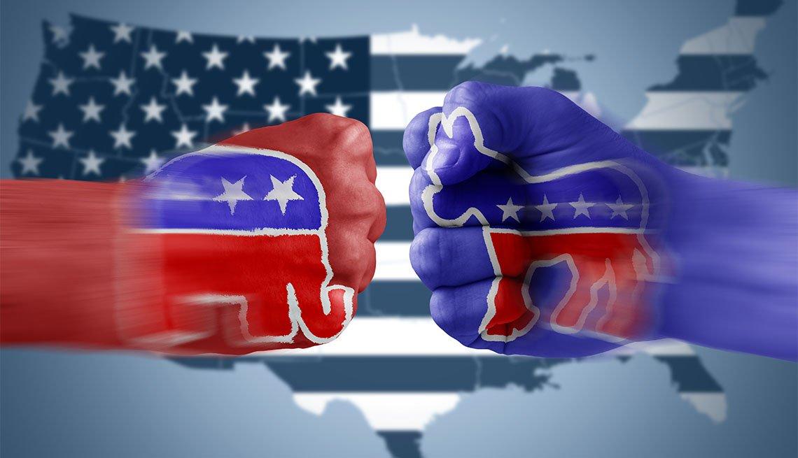 Puños de color rojo y azul sobre la bandera de Estados Unidos