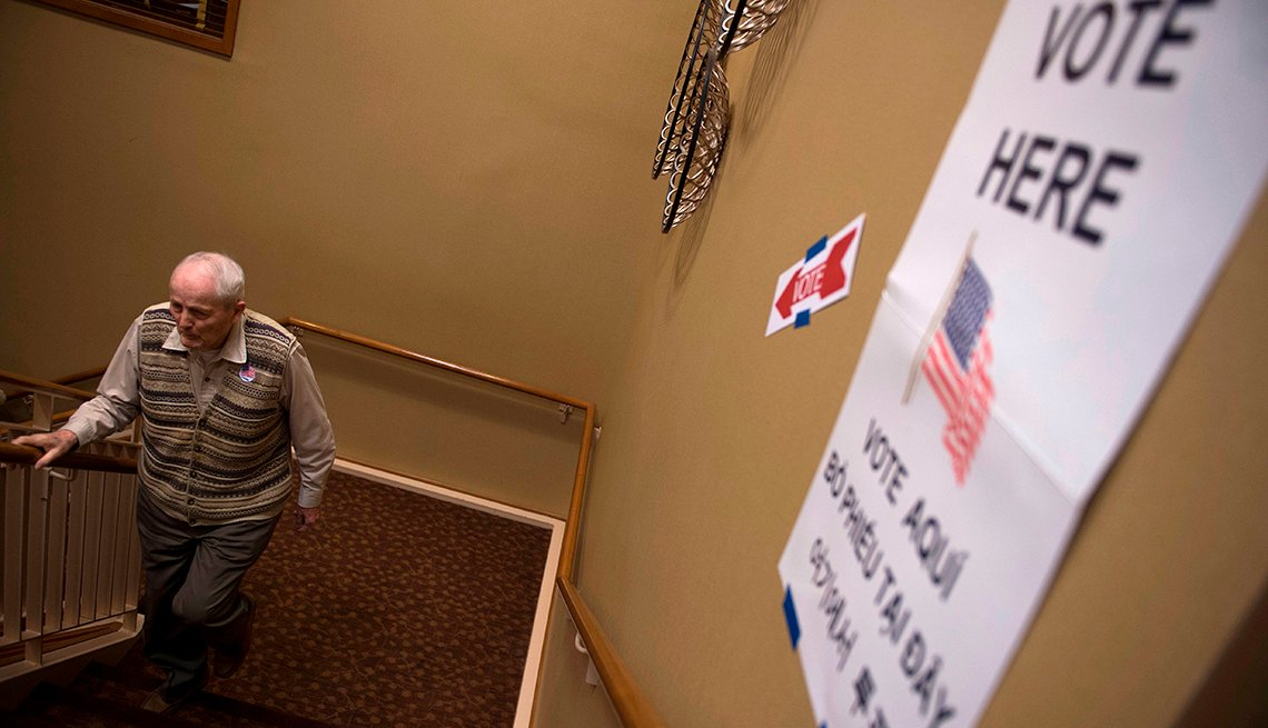 A man walks up stairs to a polling location to vote in an election