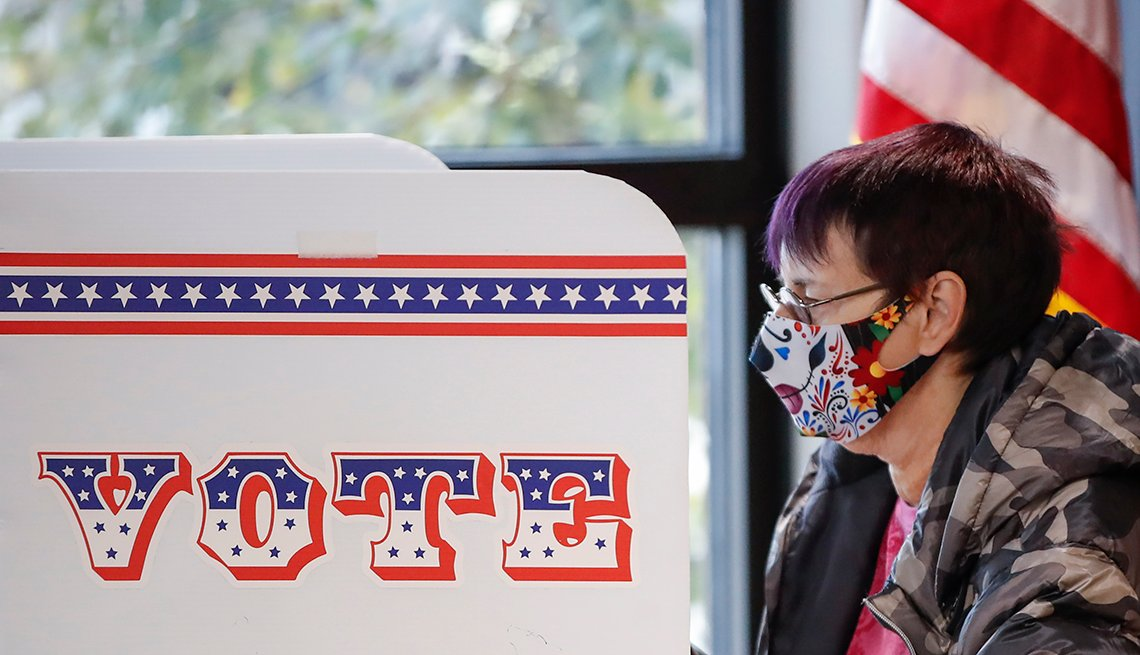 A woman is casting her ballot