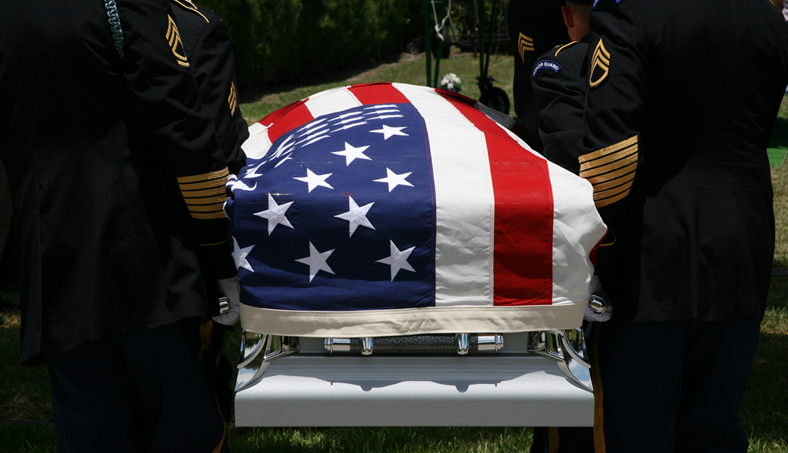 a casket covered by the american flag