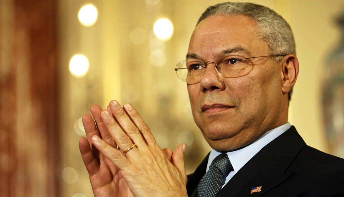 Secretary of State Colin Powell listens as President Bush speaks on trade promotion authority at the Department of State,  April 04, 2002