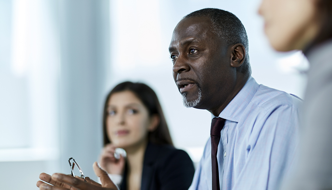 Black Business Man Sits With Colleagues, AARP Public Policy Institute, Strategic Initiatives Experts