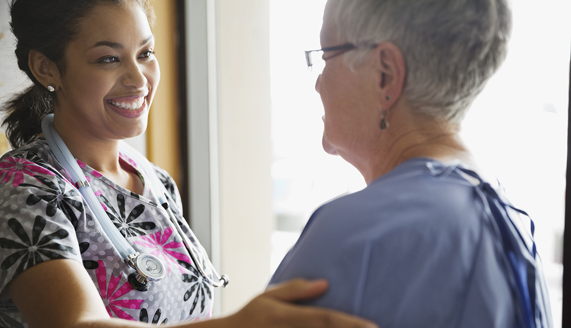 Nurse Attends To Her Patient, AARP Public Policy Institute, Champion Nursing Center