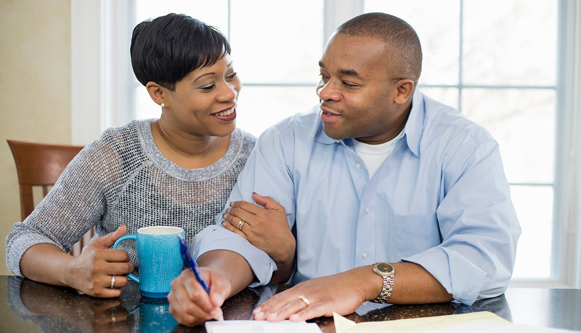 Smiling African-American couple, sitting at table, house, Middle class security project, AARP, Public Policy Institute, Initiatives
