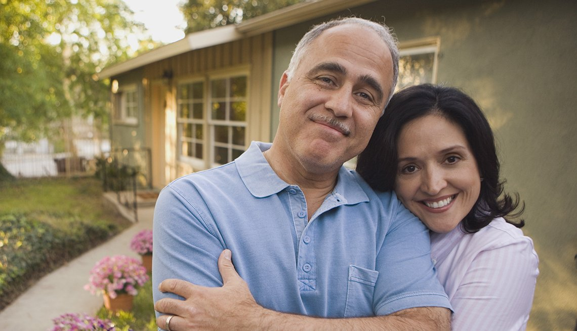 Couple hugging outside a house, AARP, Public Policy Institute, Issues, Work, Retirement