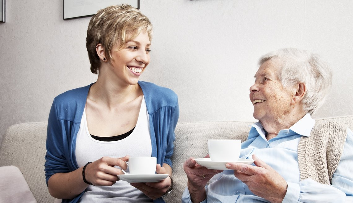 A mature woman, young woman, friendly conversation, living room, AARP, Public Policy Institute, Issues