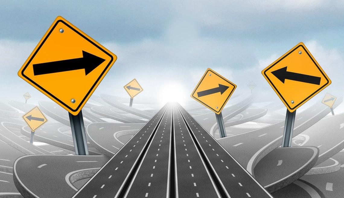 Varias carreteras con señales de tránsito que indican un camino