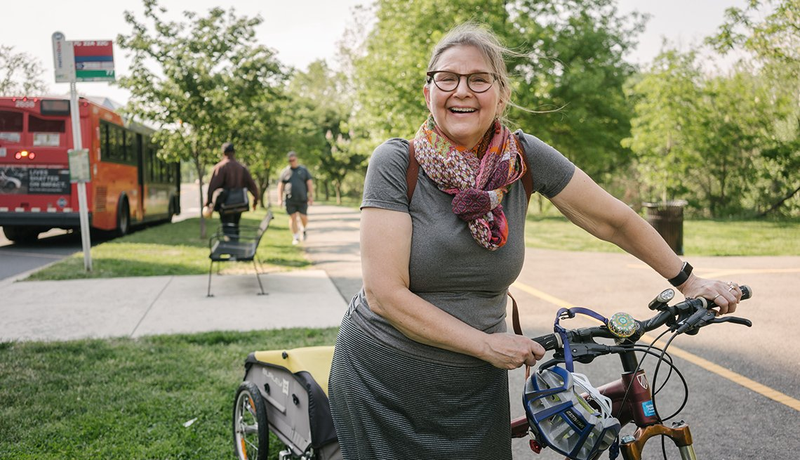 Robin Phillips holding her bicycle on a bike path