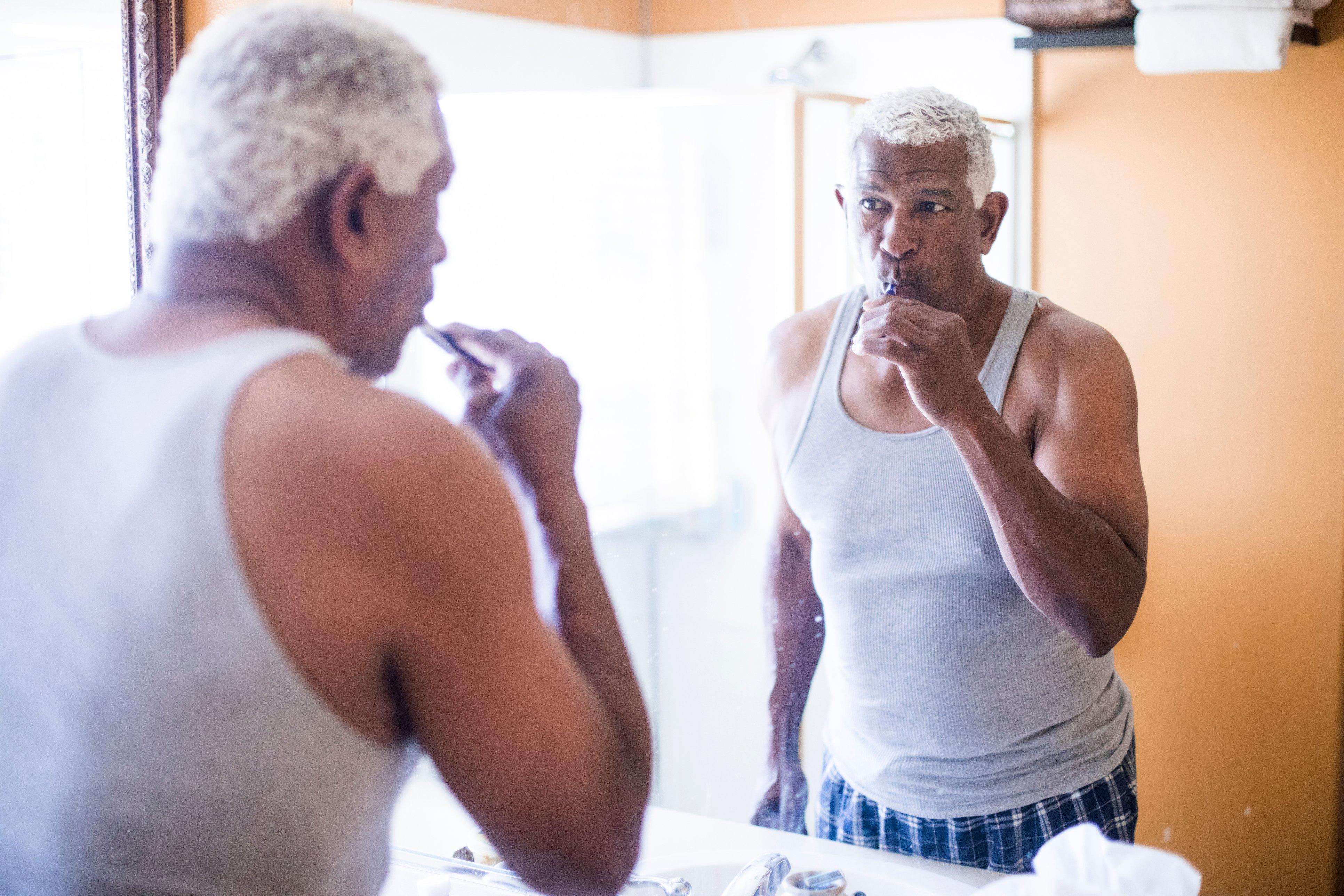 black-man-brushing-his-teeth