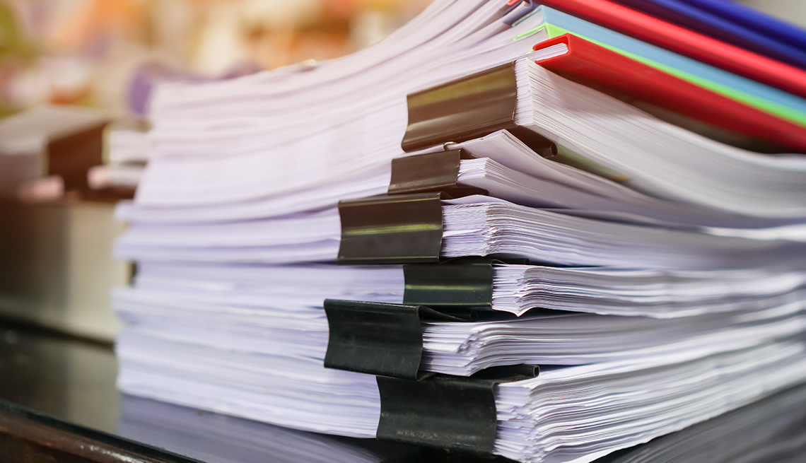 stack of papers and reports