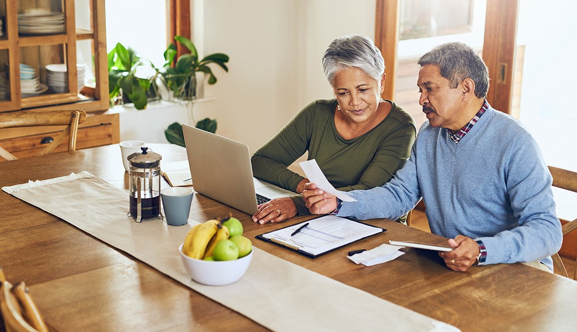 Couple manages paperwork at home